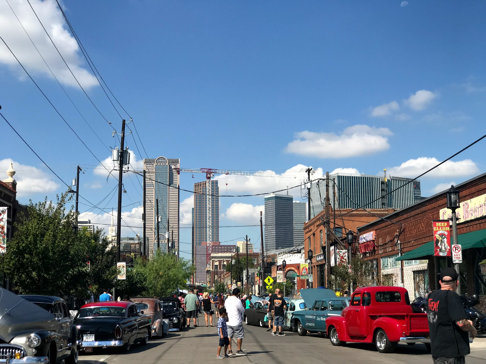 Image: People walking and watching the Car Show in Deep Ellum TeThe Invasion Car Show Deep Ellum Dallas Texasxas: