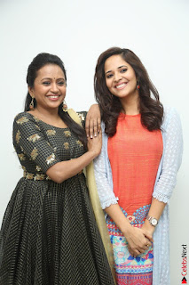 Actress Suma in Black Salwar Suit and Anusuya in orange Dress at winner movie press meet part 1 February 2017 (34).JPG
