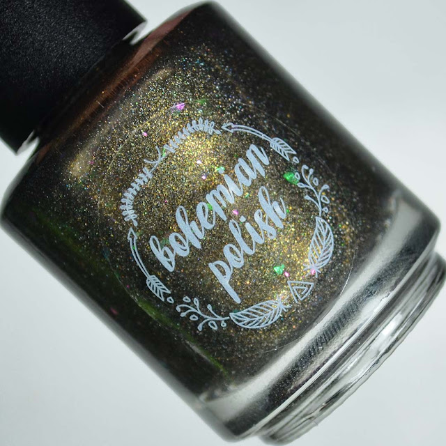 black polish with gold shimmer