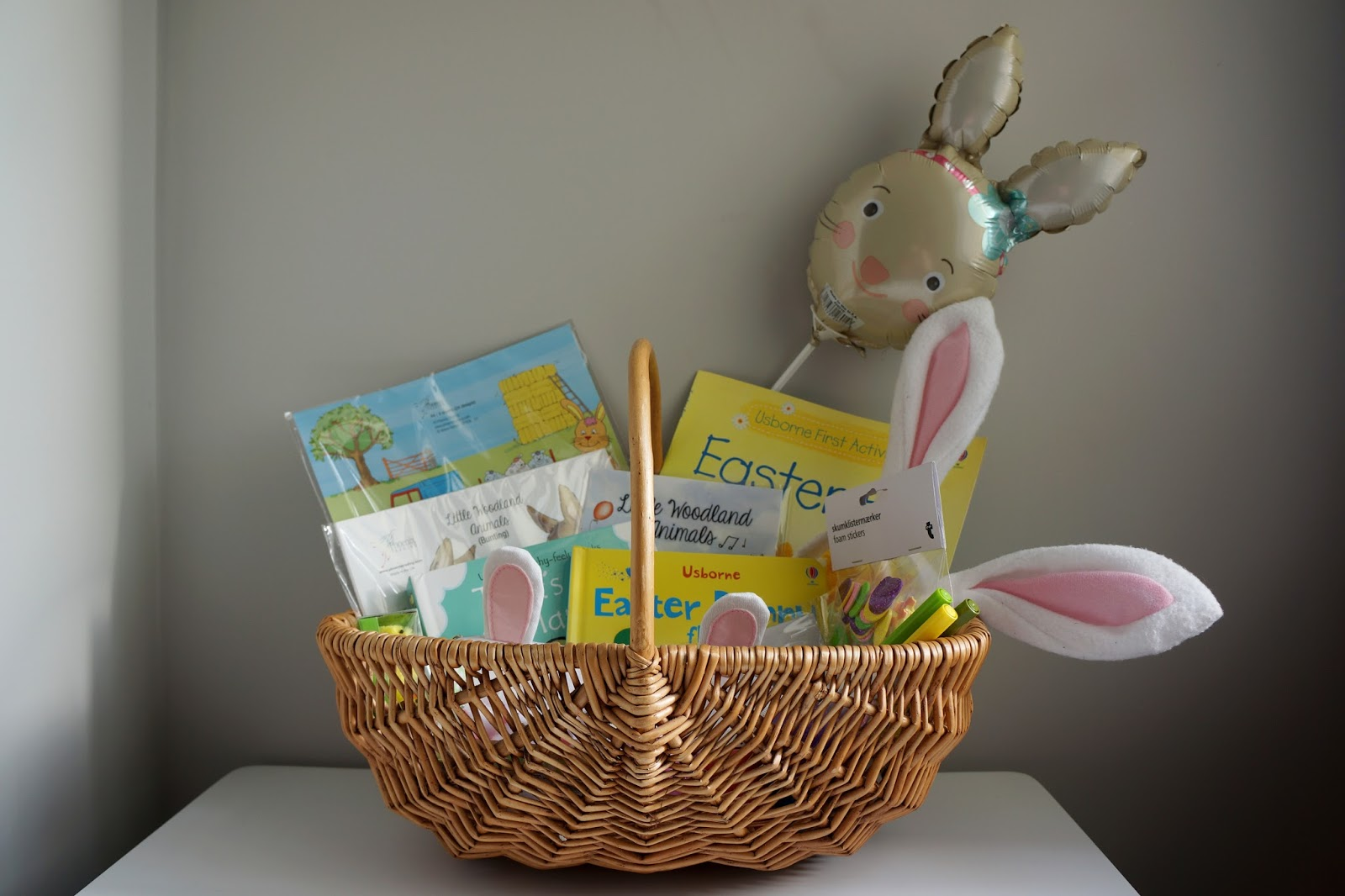 Wicker Easter basket with gifts for kids