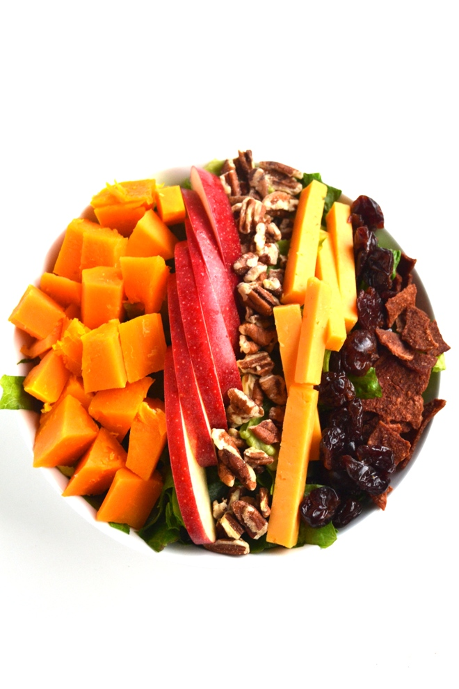 Fall Cobb Salad with Apple Cider Vinaigrette is loaded with roasted butternut squash, dried cherries, apples, pecans, bacon and cheddar for a delicious and hearty salad! www.nutritionistreviews.com