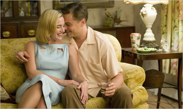 In honor of Leo DiCaprio's birthday: Still photo of Kate Winslet hugging Leonardo DiCaprio in Revoluttionary Road based on the book by Richard Yates