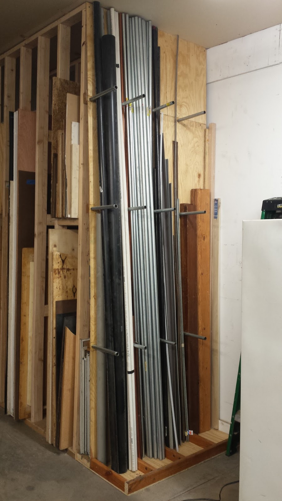 Mrx designs vertical pipe storage rack for Vertical lumber storage rack
