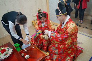 Traditional Korean wedding ceremony at wedding hall - drinking tea