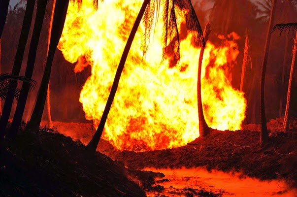 Flames rise after a blast in a gas pipeline belonging to GAIL in Nagaram village of Andhra Pradesh's East Godavari district on June 27, 2014.