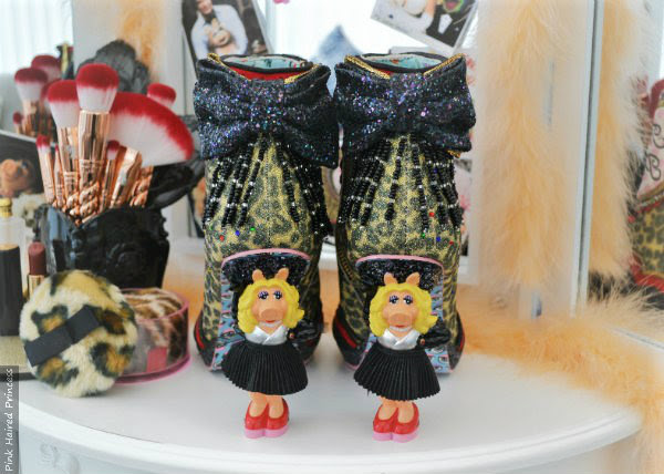 back view of Miss Piggy character heel ankle boots on vanity table