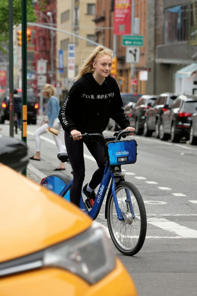 Sophie Turner riding citibikes in Soho New York