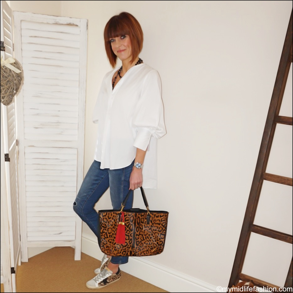 my midlife fashion, golden goose superstar low top leather calf hair leopard print trainers, massimo dutti oversized white shirt, chanel pearl necklace, brian atwood leopard print tote, j crew vintage straight leg rip and repair jeans