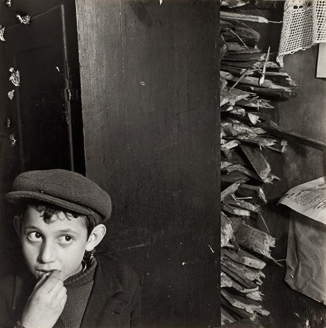 Boy with kindling in basement dwelling krochmalna street warsaw ca 1935 38