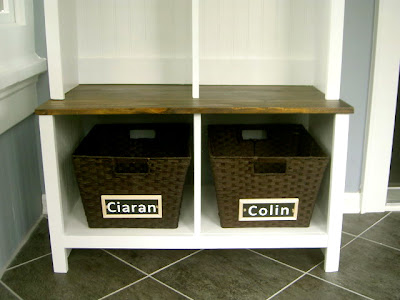 bench with storage cubbies and shoe bins