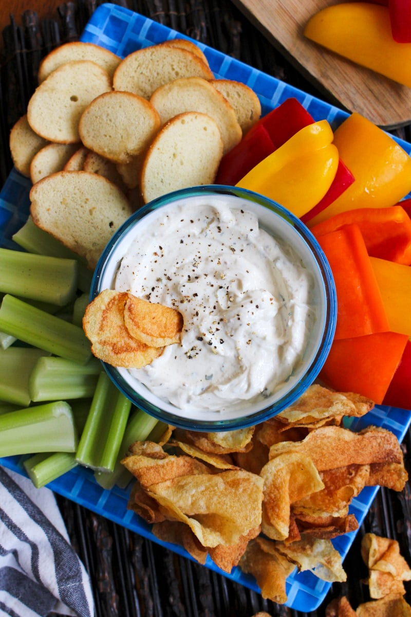 Kicked-Up Greek Yogurt Ranch Dip is made with tangy Greek yogurt, ranch dressing mix, and zippy spices. You will want to make this dip again and again!  #appetizer #greekyogurt #ranchdip