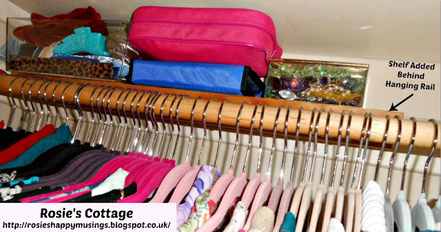 Narrow shelf placed BEHIND the hanging rail is ideal for accessories