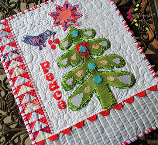 Warm Wishes Mini Quilt Free Pattern designed By Sherri Noel of Rebecca Mae Designs