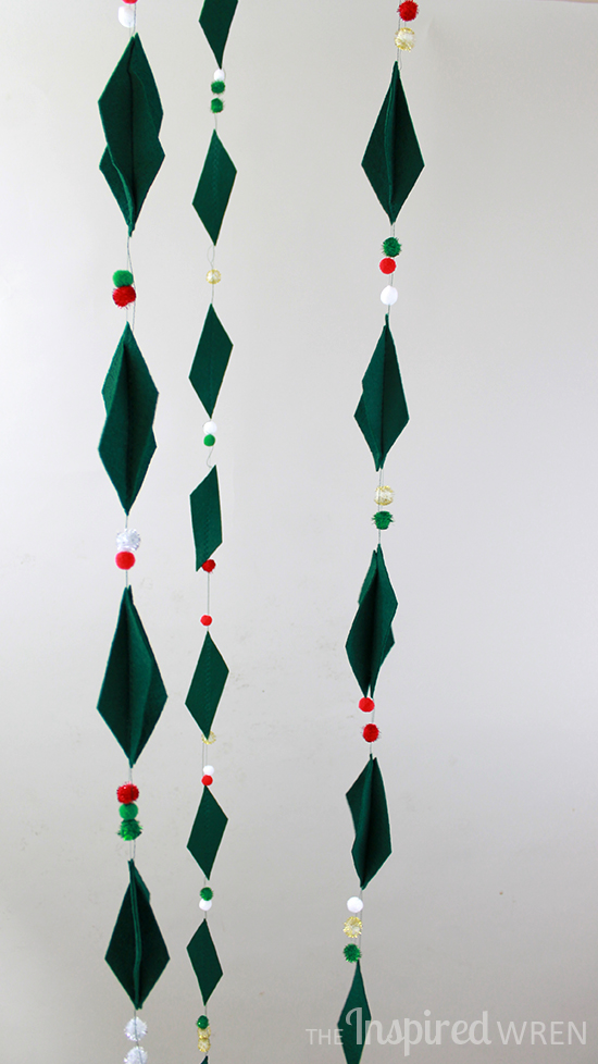 Multidimensional Felt & Pom-Pom Garland. Love it vertical like this -- perfect for an empty corner! | The Inspired Wren