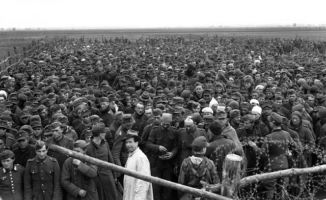 Compounds erected by the Allies for their collections of prisoners never seem to be big enough, here is an over-crowded cage of Germans rounded up by the Seventh Army during its drive to Heidelberg, on April 4, 1945.
