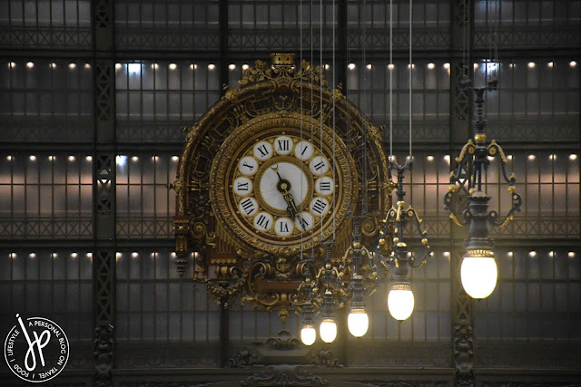 huge intricate clock, hanging light bulbs