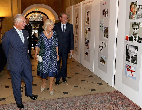 Duchess Camilla attend a reception to mark the 500th Anniversary of the Royal Mail Pearl necklace, pearl bracelet, diamond rings, jeweler, earrings