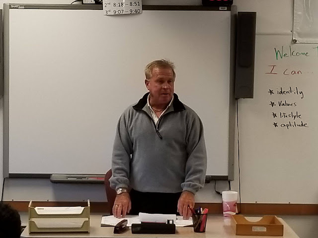 """Terry """"Rino"""" Reineke answering student questions about car buying"""