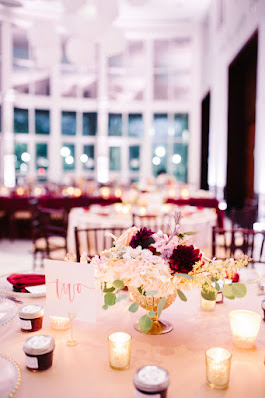 table setting with flowers and candles