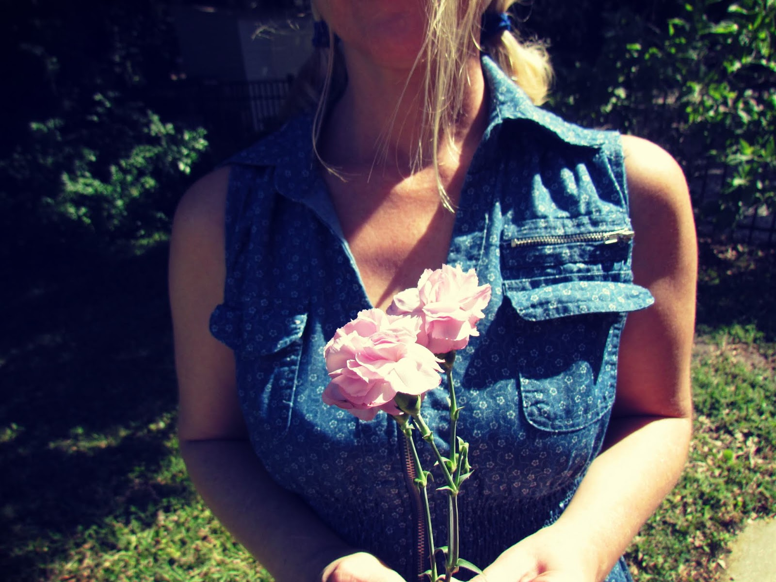 Blonde Woman in Blue Denim Dress with Flowers in a Natural Setting