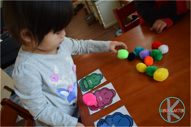 hands on color activity using pom poms and free printable