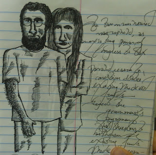 The first of the three drawings/notes in my notepad. The image is of five people. From left to right: A woman in profile faced to the viewer's left, with bangs and dark hair; a man wearing a suit, collared shirt, and tie, smiling without teeth; a man with a neatly trimmed, short beard and mustache, appearing serious; a man with a few inches long beard and mustache, a receding hairline, and a polo shirt; and a woman wearing a Muslim hijab headscarf. There are illegible notes below that.