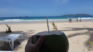 Emily with coconut water Escape to Nacpan Beach
