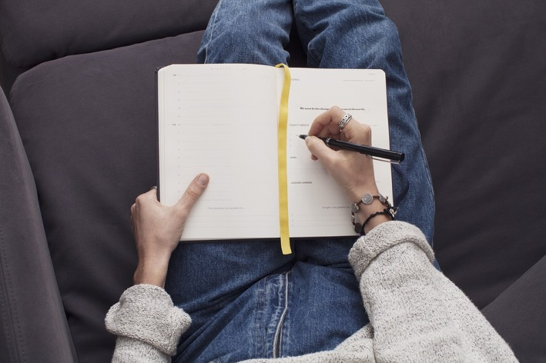 Woman Writing Thoughts In Her Journal Pixibay Image Showing Her Trying to Evaluate Her Happiness Level