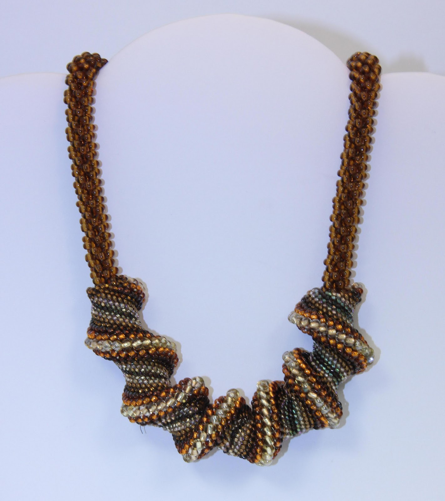 Necklace made using beaded Kumihimo—a Japanese braiding technique.