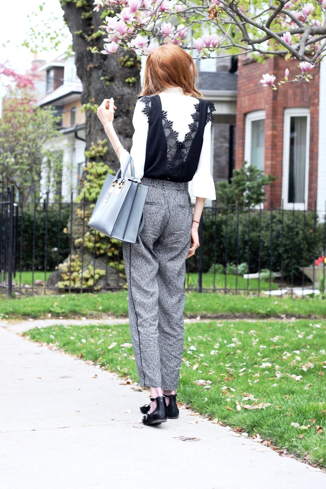 Vero Moda polka dot trousers, white mock neck knit, RW &CO lace cap sleeve blouse, Target flats, Sophie Hulme tote bag charcoal  grey, Celine Caty sunglasses
