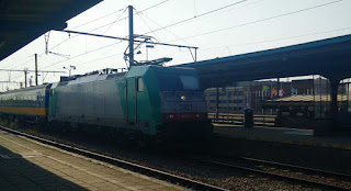 An old diesel pulling a passenger service