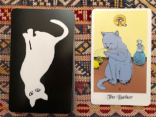 Bather card from white cat oracle deck by artist David Borden