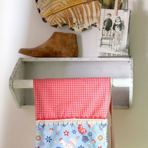 wooden tool box  repurposed into a kitchen shelf - with kitchen towel hanging on it
