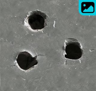 تحميل ثقوب طلقات الرصاص