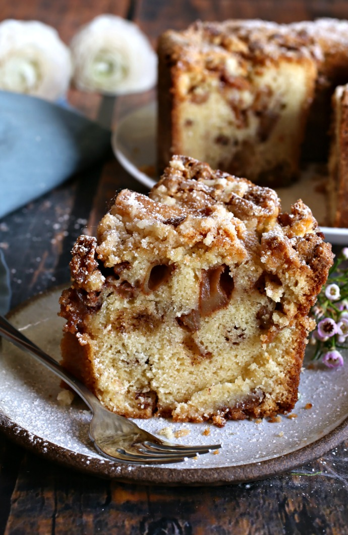 Recipe for a tall cake, bursting with apples, and topped with a brown sugar crust.