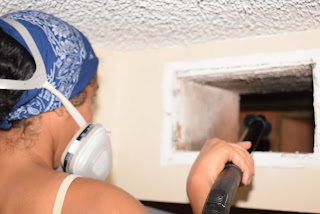 Woman cleaning an AC Duct & Vents
