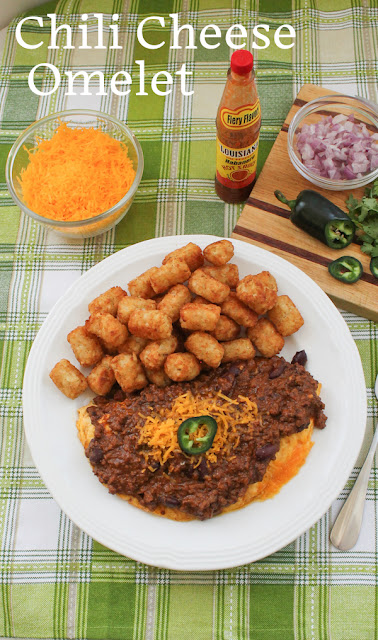 Food Lust People Love: Try my hearty spicy beef chili on top of a fluffy cheese omelet, great for breakfast, lunch or dinner! #SundaySupper