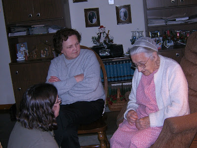 Great Aunt Anna, Quiltpieces, and Madame Blueberry sitting and talking.
