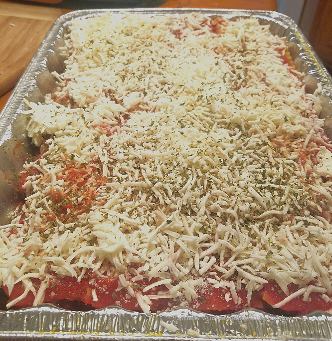 this is how to make my mom's lasagna with meatballs, sausage, lasagna pasta and sauce