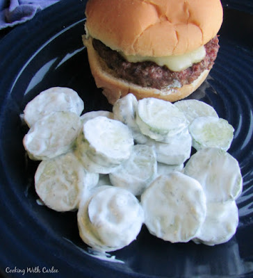 creamy cucumber salad served with a hamburger