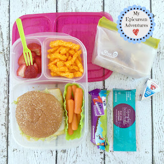 Lunch box fun with ham and cheese sandwich on whole wheat bun. In our @easylunchboxes #lunchboxideas