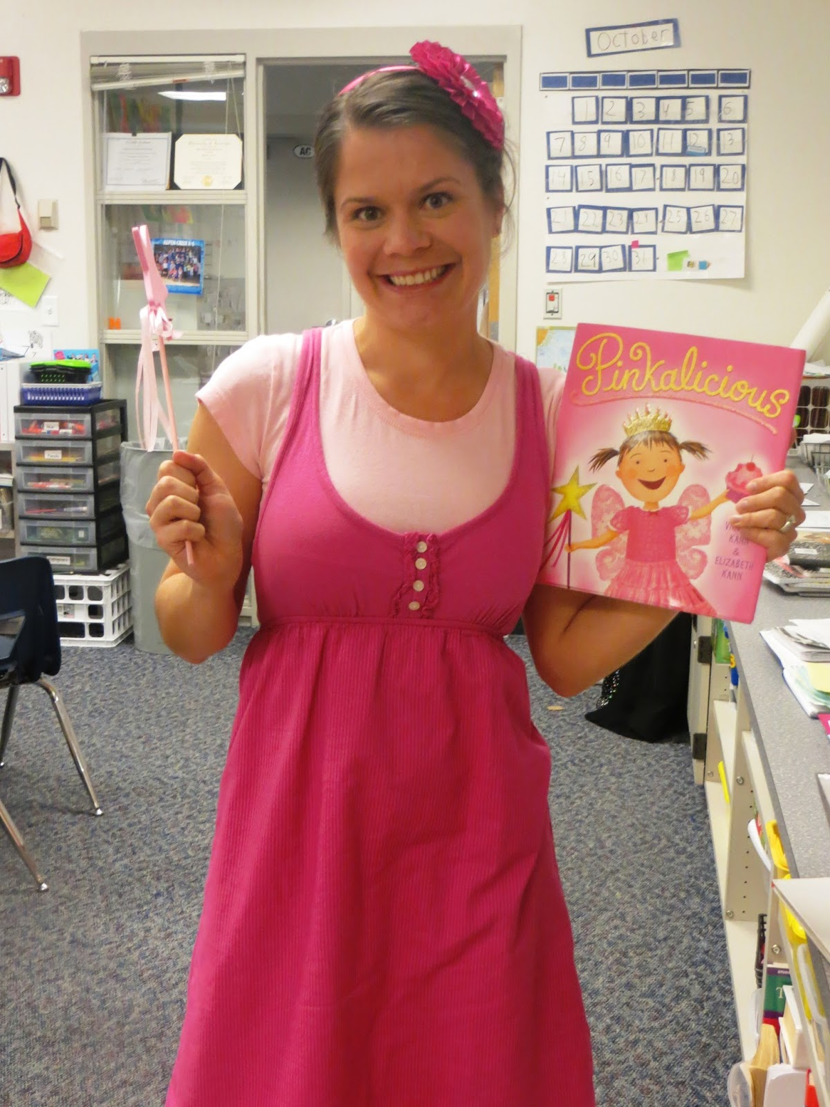 A simple idea for a teacher Halloween costume! Be Olivia for Halloween! Put together your own book character costume with just a dress, ears, and tights. Click for links and instructions. The ears are my fave!