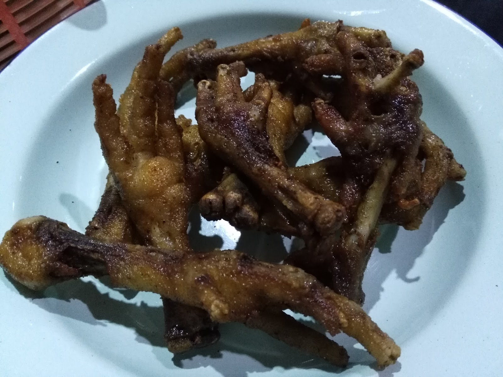 ... fried kangkong (water spinach). Another famous dish is the deep-fried