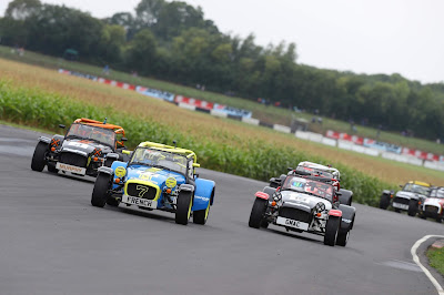 Leading the pack into Quarry corner on lap one of the 2018 Caterham Roadsport Race at Castle Combe circuit