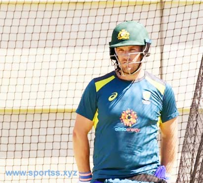 Helping hand: Australian opener Aaron Finch speaking to former captain Ricky Ponting in Perth yesterday