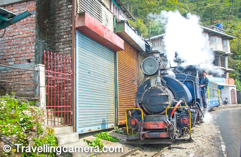 "The Darjeeling Himalayan Railway (DHR), also known as the ""Toy Train"", is one of the most famous relics of the British Colonization of India. This narrow-gauge (2ft) railway runs from Siliguri to Darjeeling, in West Bengal, covering a distance of 88kms and travels from an altitude of 100m in New Jalpaiguri to 2,200m in Darjeeling.   The railway is based on zig-zag and loop-line technology. The DHR has 6 zig-zags and 5 loops. The Zig-Zag technology is used by mountain railways to gain elevation without using tunnels. This technology is also known as the switchback technology. Basically, after covering one stretch of elevation, the train travels in reverse to cover the next stretch of elevation. It resumes the forward direction for the next stretch, hence traveling in a zig-zag manner, instead of going around the mountain or through a tunnel. The length of the train cannot be greater than the shortest stub track on the the zig-zag so that the train is able to successfully reverse here.  Loop-line technology is used to ensure that faster trains are able to overtake slower trains on a route. Whenever a faster train approaches and needs to overtake another train, the slower train is moved to a secondary track, known as the loop line, and the faster train can overtake using the primary track. In this case too, the maximum length of the trains that can run on the route needs to less than the length of the loop line. As mentioned, Darjeeling Himalayan Railways has 5 such loops.   When the DHR was constructed in the late 19th century, it was driven by steam locomotives. Over the years, Diesel locomotives have mostly taken over the regular service, the tourist trains from Darjeeling to Ghum and the Steam Enthusiast Specials are still pulled by quaint little steam engines. These are vintage locomotives built by the British. A total of 34 of these B-Class locomotives were built by Sharp, Stewart and Company and the North British Locomotive Company from 1889 to 1925. However, only a handful of these are still in use. Nevertheless, the sight of these marvelous engines bellowing steam while traversing the streets of Dalhousie is fantastic.   The DHR follows the Hill Cart Road and often for long stretches the track runs alongside the road. The entire area is prone to landslides, especially during the rainy season. It was still summer when we were there, and yet it rained heavily almost everyday. However, despite the risk of landslides, it will probably be beautiful after the rains. I can imagine the clouds hanging over the valleys and the little train tearing through them to make its way towards the destination.   The journey from New Jalpaiguri to Darjeeling takes a little over 7 hours. This is the regular service that runs every day during the season and is pulled by Diesel Engines. However, the train often runs late. The train stops at 8 stations enroute, but there are stretches where the train moves so slow that it is possible to hop on and off the train while it is in motion. However, we do not advise that you do that.   Apart from the regular long route, there are joyrides that are available between Darjeeling-Ghum-Darjeeling. The ticket prices are different for trains hauled by steam engines and those hauled by Diesel Engines, the ones hauled by steam engines being slightly more expensive. Apart from this, there is a Toy Train Jungle Safari which runs from Siliguri to Rangtong and back. This takes approximately 3 hours and is hauled by the Steam Engine.   Though the Toy Train Circuit was built to meet the transportation needs during the British Era, the journey has not lost its charm till date. This is probably the biggest tourist attraction in this region and even today, you need to book your seats days in advance, otherwise there are chances that you may not get a seat. A lot of energy and money is spent to maintain the trains, engines, and the tracks. But ultimately, we feel that it is worth it. In the year 1999, UNESCO made the Darjeeling Himalayan Railway a UNESCO World Heritage Site.   The Toy Train has also starred in several Bollywood movies. It is featured in the famous song ""Mere Sapnon ki Rani"" starring Rajesh Khanna and Sharmila Tagore. It also makes an appearance in the film Barfi, starring Priyanka Chopra and Ranbir Kapoor. Therefore, this little railway is also bit of a celebrity.   Even if we leave aside the Historical value and the Celebrity status, the sight of this little colorful train snaking along the road in Darjeeling is quite a treat especially when the weather is good and the hills are green. But if you want to experience a ride, you need to plan in advance. May be the entire journey from New Jalpaiguri to Darjeeling is too long, and we have heard that many coaches are not equipped with toilets too. So it may be more comfortable to book a joyride to experience this enchanting journey at least once."