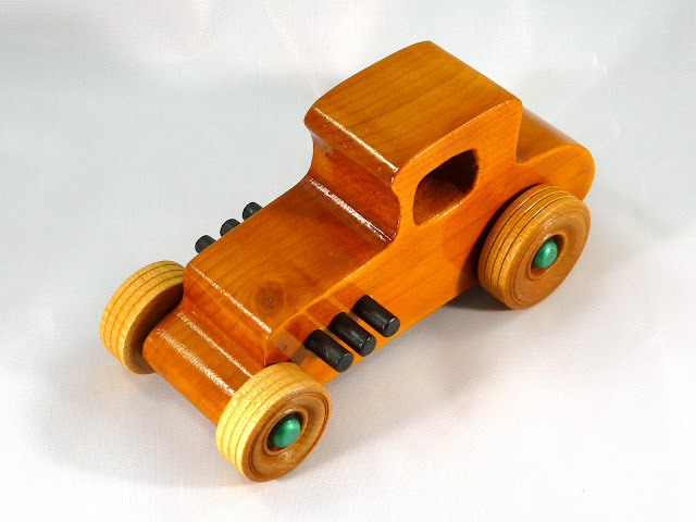 Top Left Front - Wooden Toy Car - Hot Rod Freaky Ford - 37 T Coupe - Pine - Amber Shellac - Metallic Green Hubs