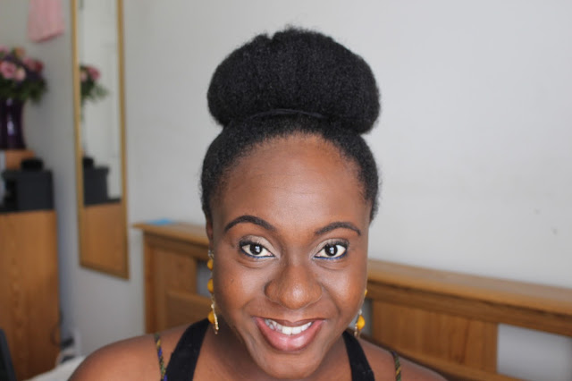natural hair styles, natural high bun, natural hair mega bun, protective styles, berry dakara, african naturalistas, black hair, professional natural hair