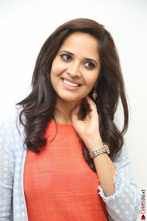 Actress Anasuya Bharadwaj in Orange Short Dress Glam Pics at Winner Movie Press Meet February 2017 (99).JPG
