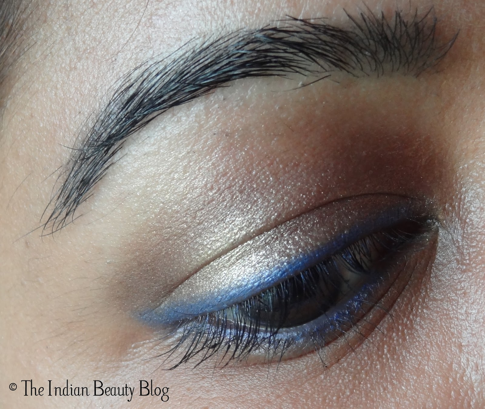 Copper-brown eye make-up with blue eyeliner and kohl: make ... - photo#7